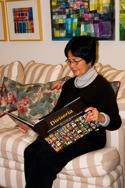 Susan engrossed in Andre's DIVISORIA pictorial book.