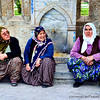 Three women resting on the sidewalk of Istanbul in Turkey.