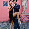 Tango dancers posed for picture at La Boca district of Buenos Aires, Argentina. All dancers out on the street posing for pictures have long and beautiful legs.