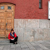 A Russian woman resting on the steps of a building inside the Kremlin wall. Spotted in Moscow, Russia.