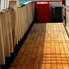 View of a side deck that continues towards the rear of the ship.