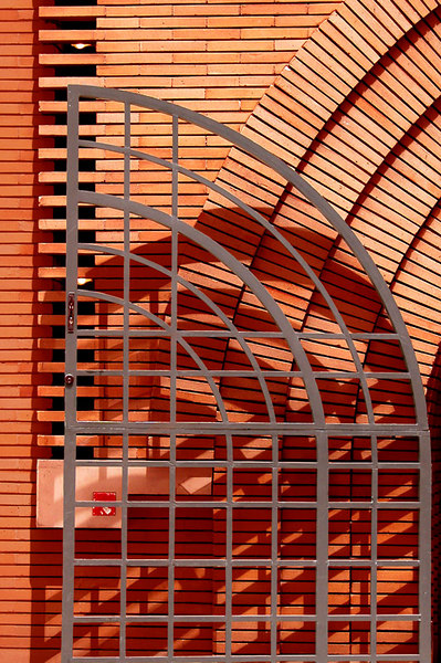 A close view of the gate and brickwork of the building by Frank Lloyd Wright.