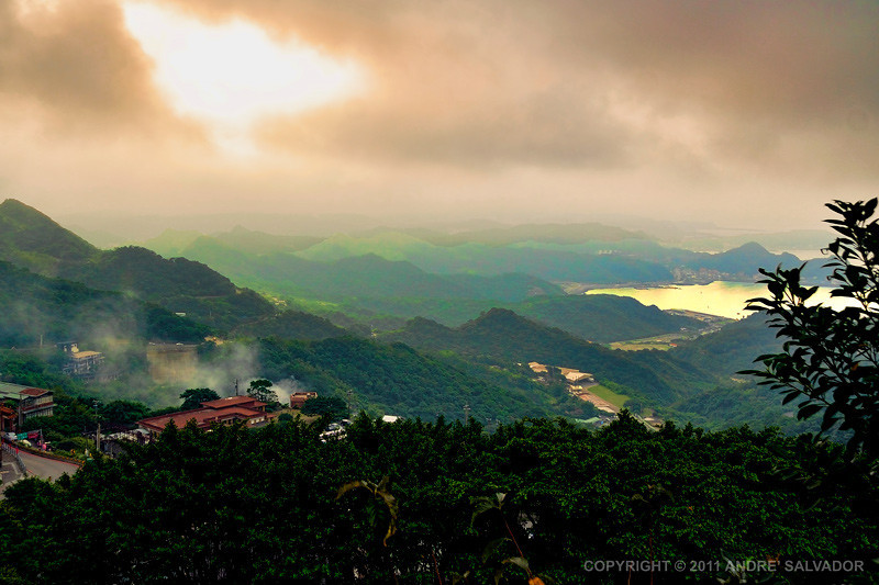 Foggy and cloudy sunset at the northeast coast of Taiwan, Republic of China. The Chiufen Village is seen at foreground.