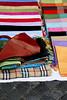 Silk cloths on a sidewalk sale in Rome, Italy.