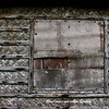 A battered window of an old residence in the monastery ground. Tha walls are made of local bamboo and nipa palm leaves.